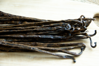 Stack of vanilla beans on wood board