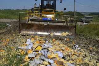 Bulldozer destroying cheese