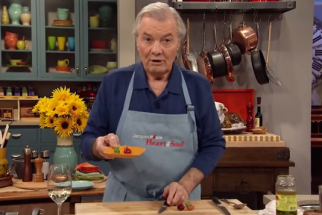 Jacques Pépin holding grapes shaped like bunnies