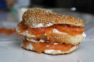 a bagel with cream cheese and salmon