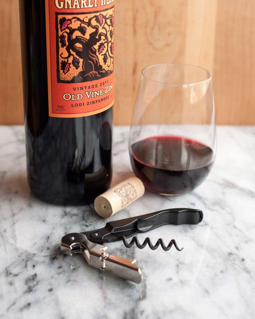 how to open a bottle of wine using a wine key corkscrew kitchn. Black Bedroom Furniture Sets. Home Design Ideas