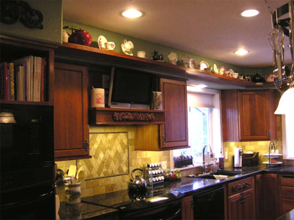 How Can I Decorate The Tops Of My Kitchen Cabinets?