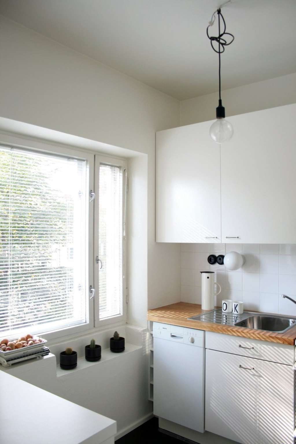 How To Downsize a Kitchen: 8 Tips for Owning Less in the Most Space-Sucking Room in the House