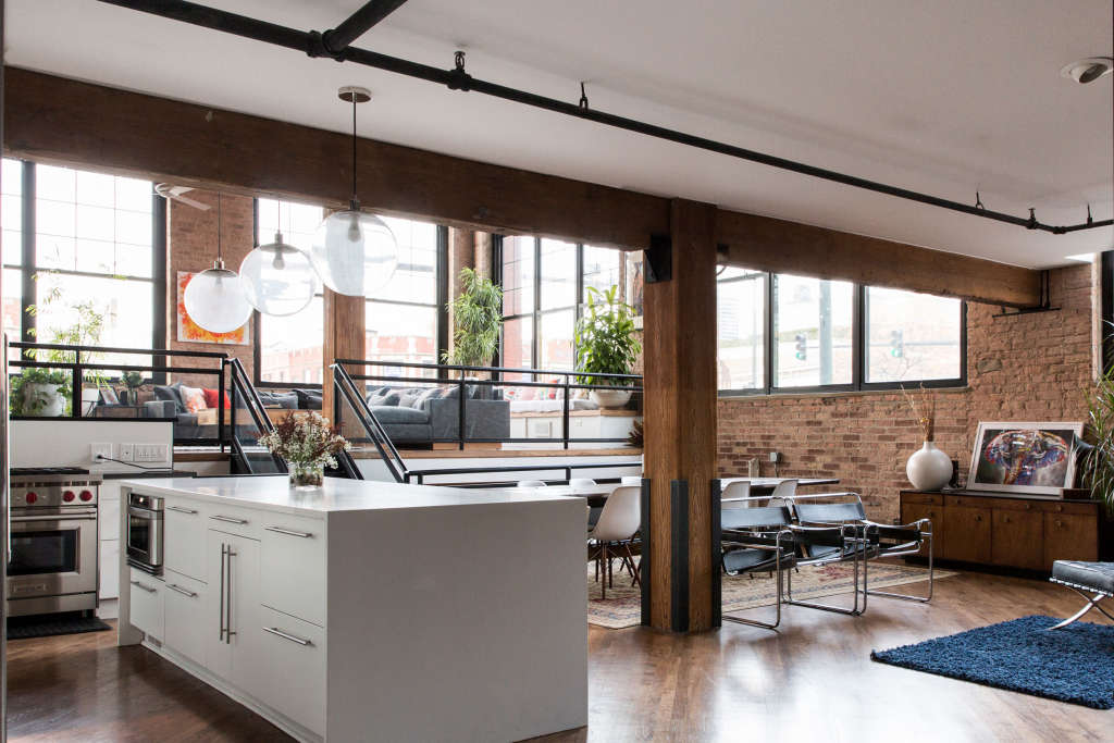 A Warm Industrial Loft's Big But Full of Cozy Spots to Chill