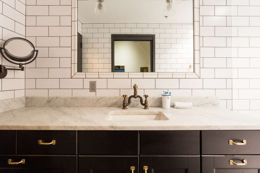 This Big Bathroom Trend Turns Traditional Tile on Its Head