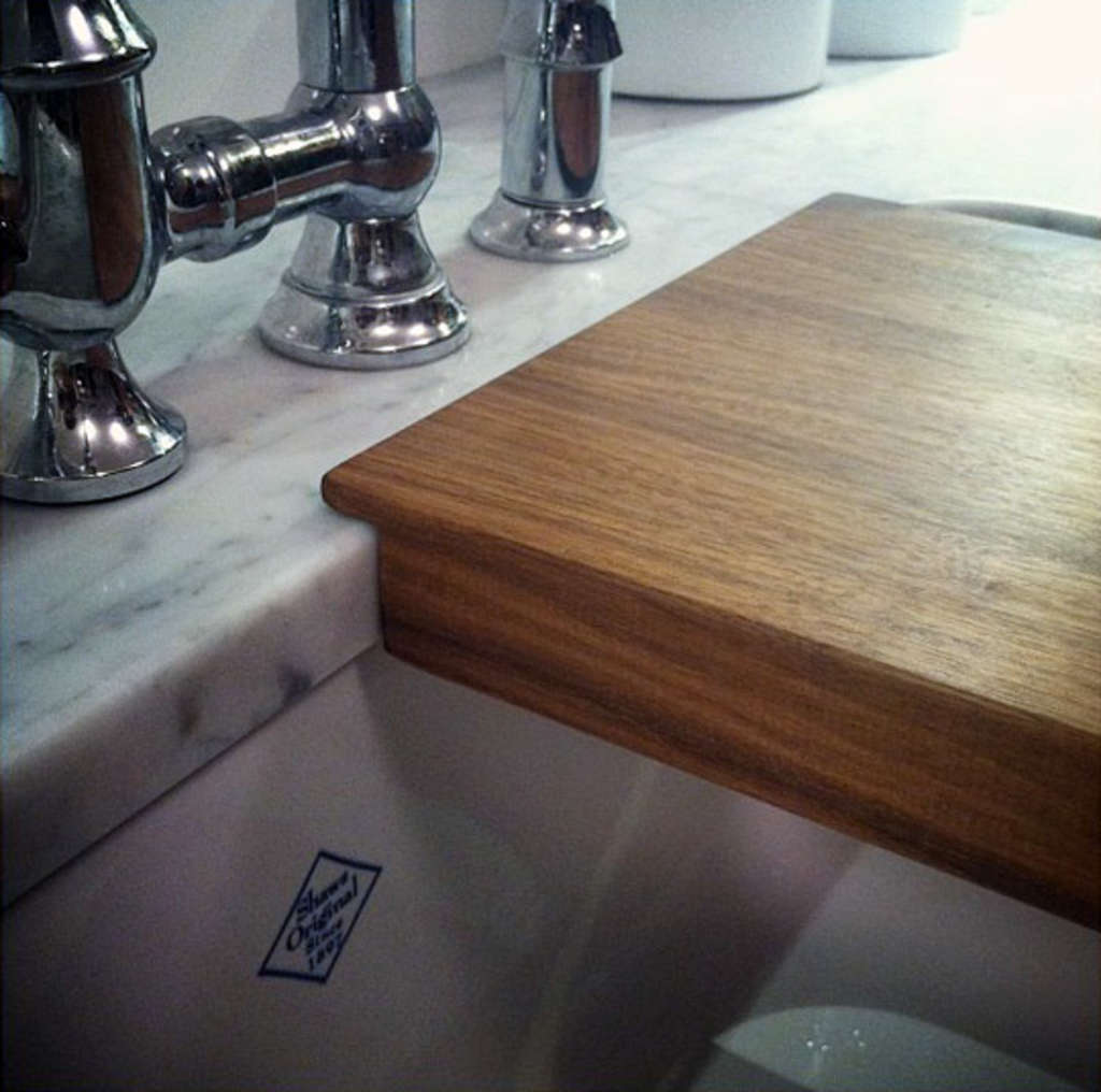 tips on getting an integrated cutting board for your sink kitchn. Black Bedroom Furniture Sets. Home Design Ideas