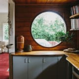 Wood paneling and round window