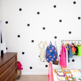 girl's bedroom with white and black polkadot wall
