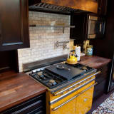 Golden yellow oven with dark cabinets
