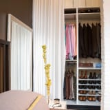 organized clothing closet shoes storage boxes with curtain