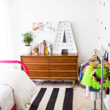"girl's nursery with polka dot accent wall and large metal letter ""A\"""