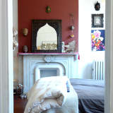 The bedroom and its eclectic objects.