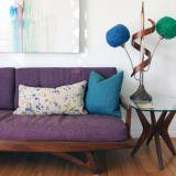 Purple couch and unique lamp