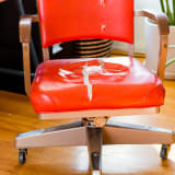 Ripped vintage office chair