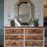 Rustic dresser with silver octagonal mirror above