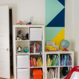 Rainbow color-coded bookshelves