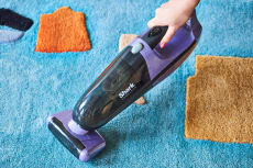 Shark vacuum being used on carpet