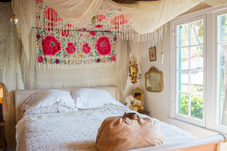 Bohemian style bedroom with lace canopy bed
