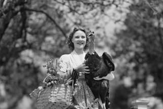 Woman Carrying Live Turkey