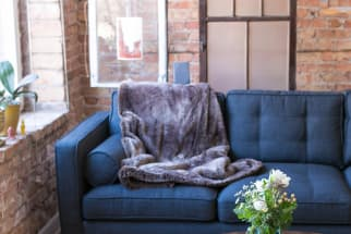Living Room Sofa with Exposed Brick Hanging Windows