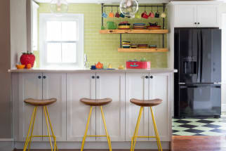 Farmhouse kitchen with yellow metal bar stools