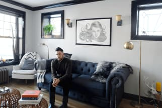 Matthew sits in his sunny 1-bedroom apartment in Avondale, Chicago.