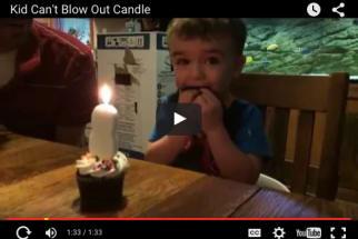 Kid and Birthday Cupcake