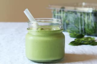 Green smoothie in small glass