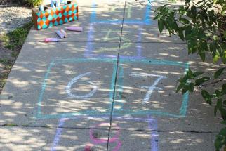 Chalkboard hopscotch board on a sidewalk