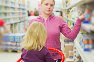 Mother and toddler shopping for groceries.