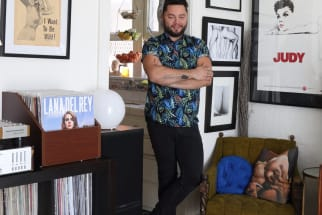 homeowner in his living room with record collection and framed judy garland poster