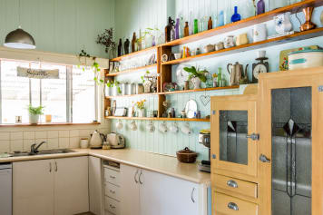 This Little Trick Will Add A Bit More Storage To Your Open Shelving