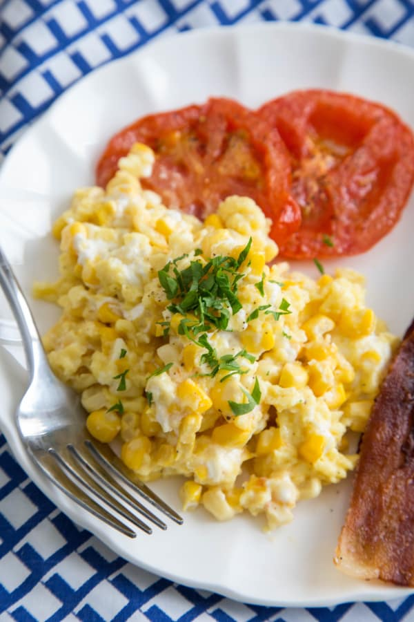 Scrambled eggs with corn and tomatoes
