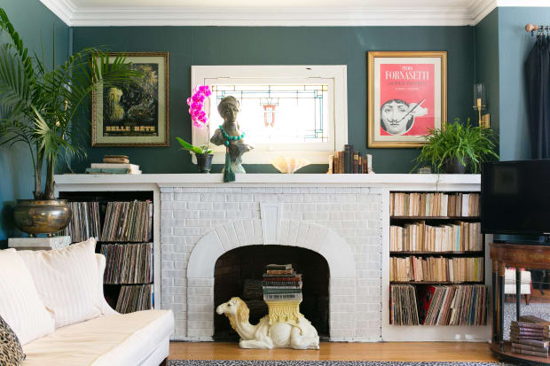 The Fireplace With Shelves, Typical Of Logan Square Apartments Is Filled  With Their Collection Of