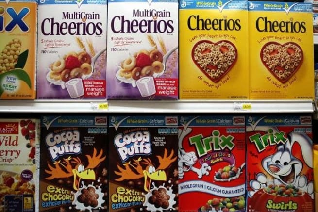 Boxes of General Mills Cereals on the Grocery Store Shelf