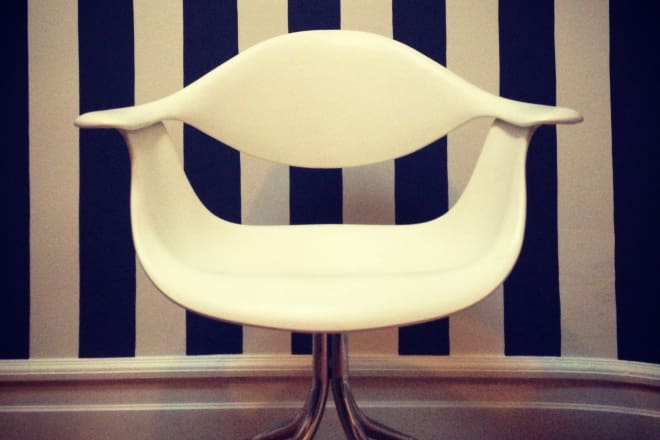 Home office wall with painted black and white stripes and white modern chair