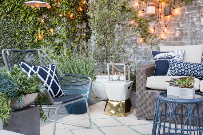 patio with chairs, string lights, and candles