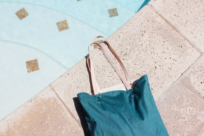 teal bag by pool