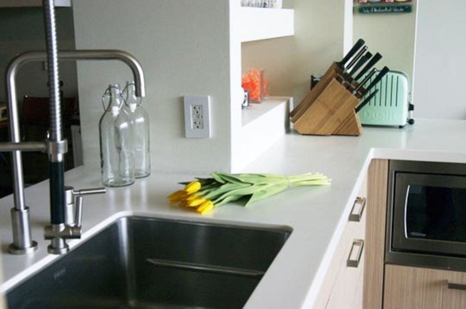 All about synthetic solid surface countertops kitchn for Synthetic countertop materials