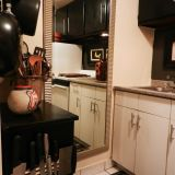 Jamie's Glossy Black Rental Kitchen —  Small Cool Kitchens 2012