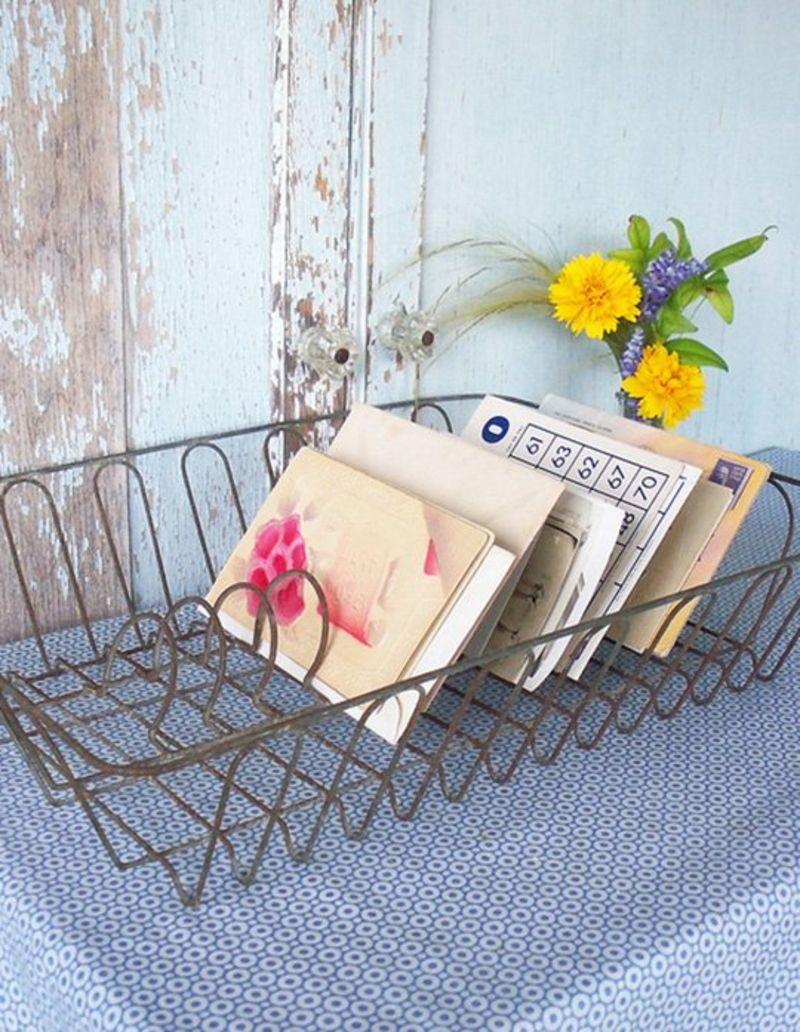 Vintage dish rack holding mail and other paper ephemera.