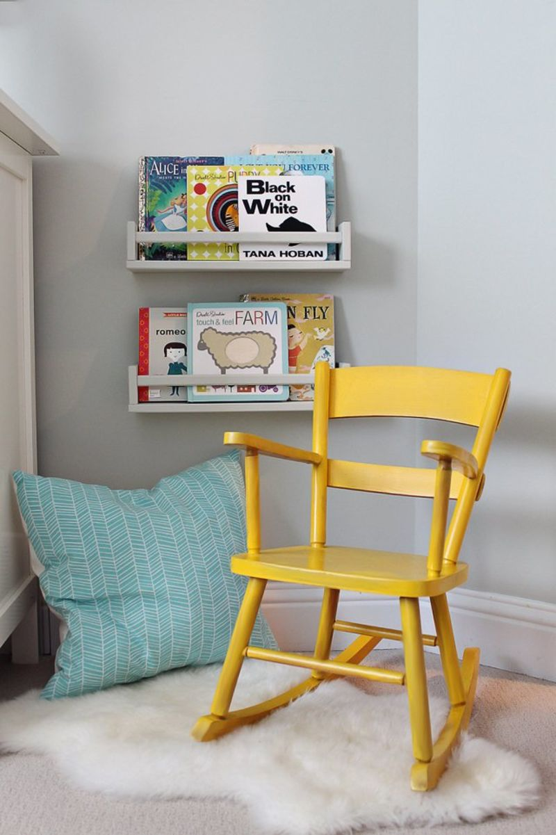 IKEA spice rack being used as book storage in a children's room.