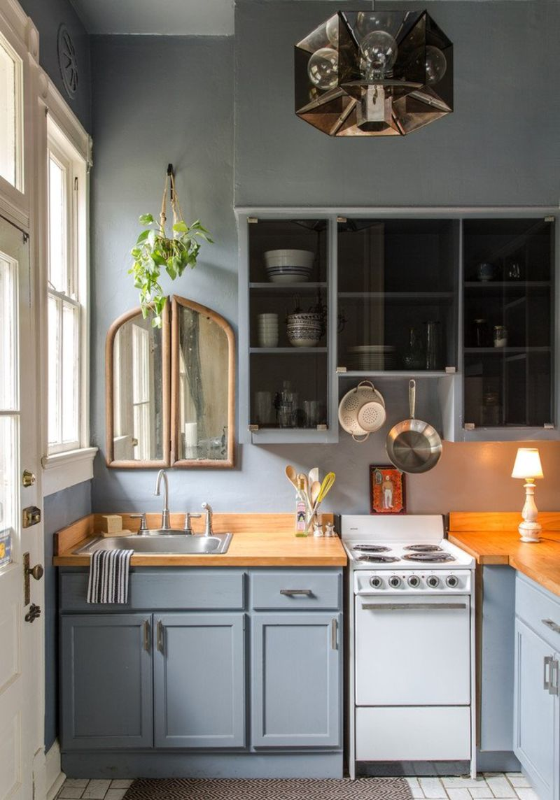 Blue kitchen with small table lamp and