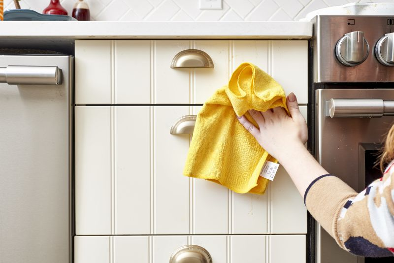 how to clean sticky kitchen cabinets