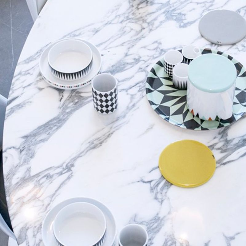 Warren Plater Style dining table with plates from Rove Concepts