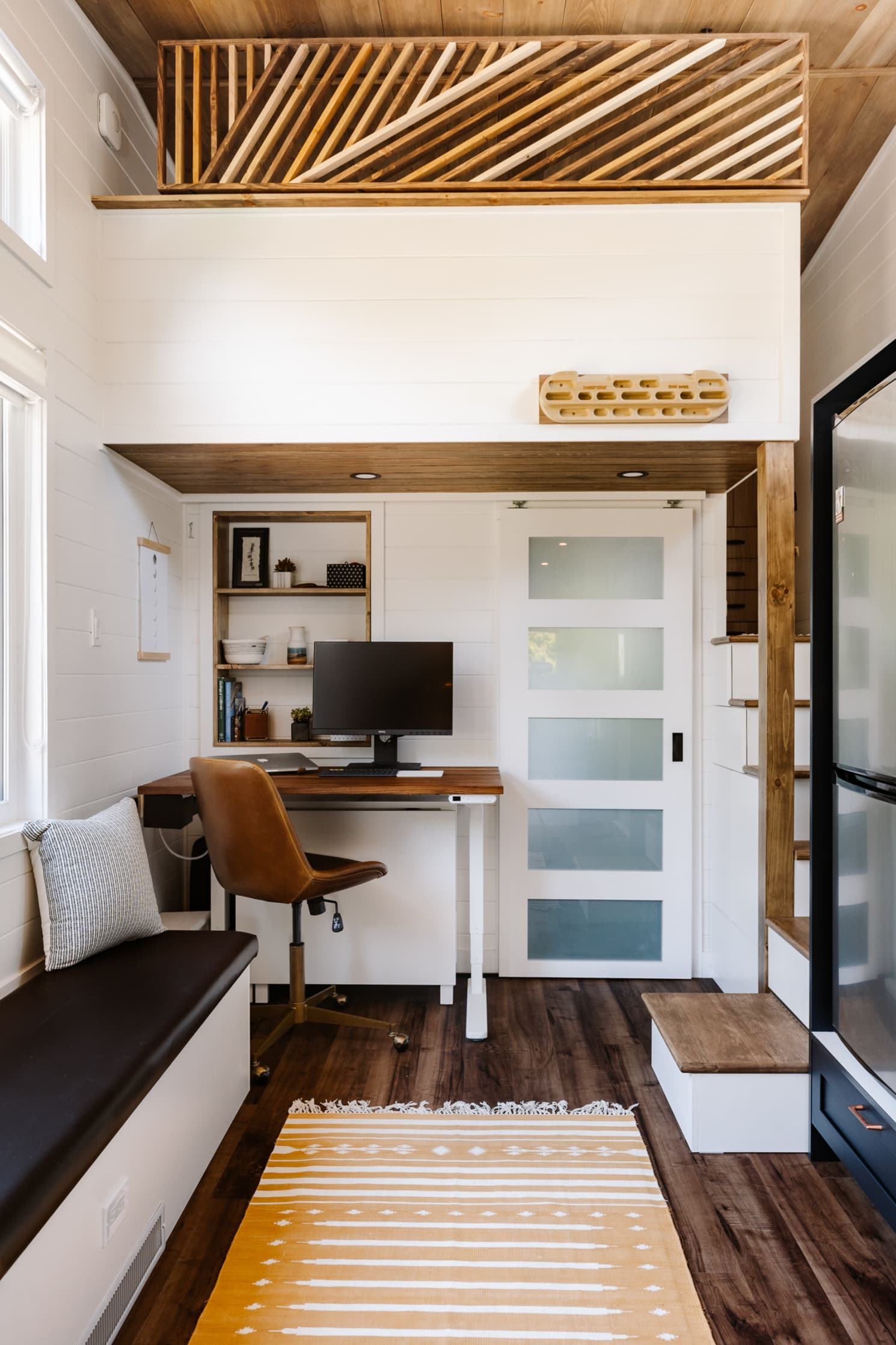 Smart tiny home with office space and wooden flooring