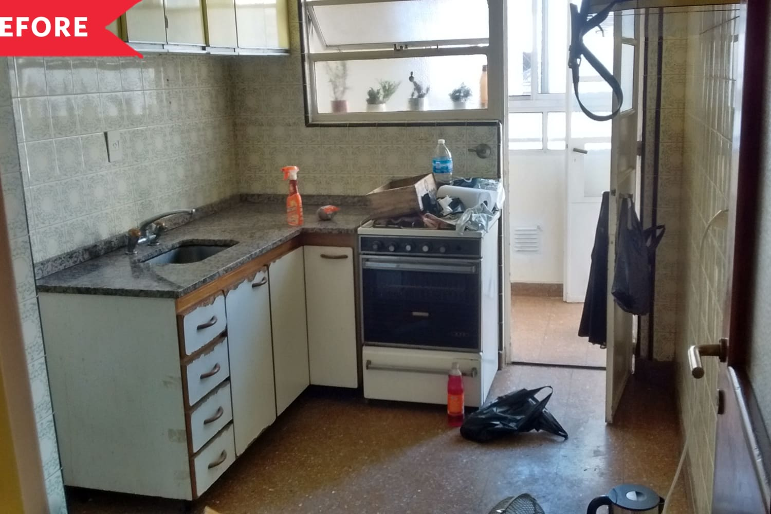 "Before and After: A ""Catastrophic"" Kitchen's Stunning Redo Includes a DIY Faux Cement Wall"