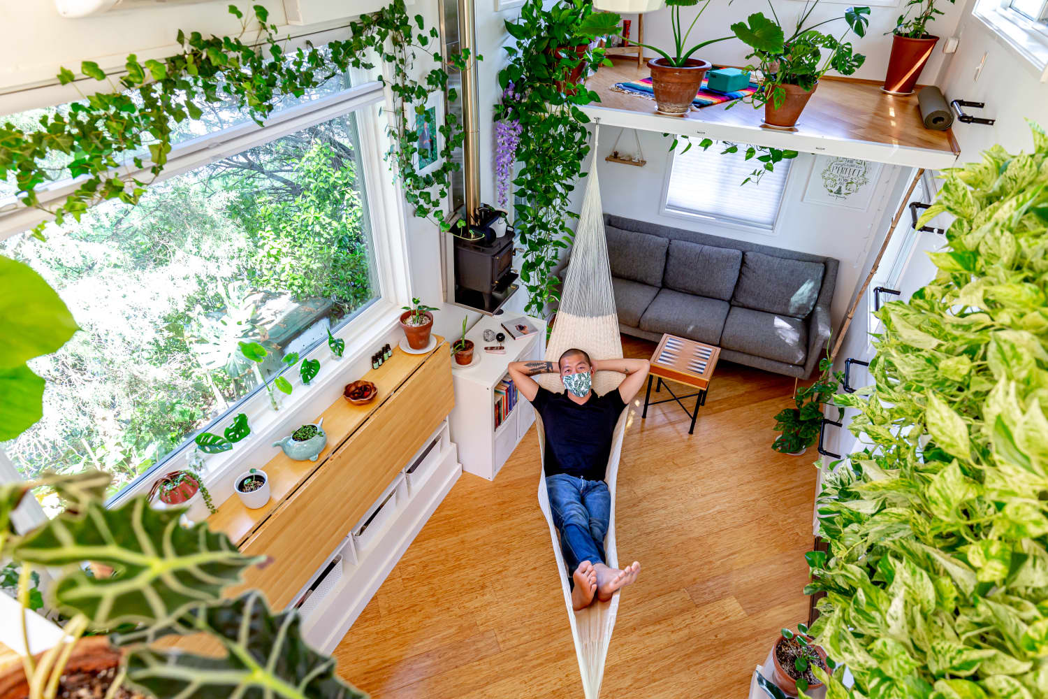 This 296-Square-Foot Tiny House Has Tons of Plants, over 14 Windows, a Hammock, and a Meditation Loft