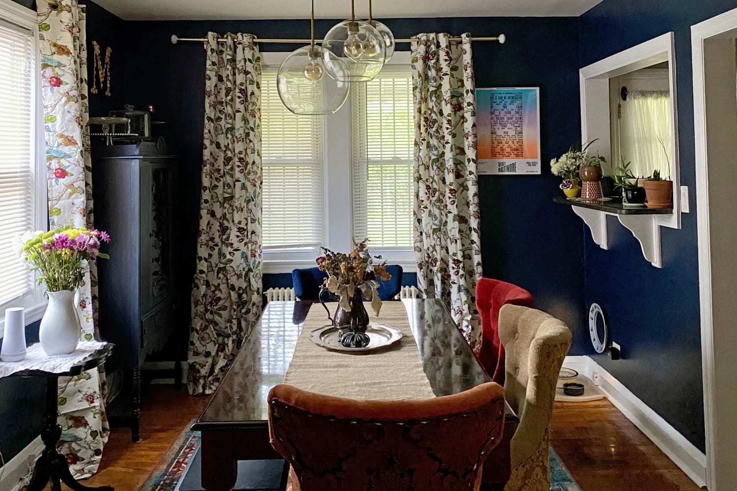 A Baltimore Brick Row Home Has Gorgeous Navy Dining Room Walls