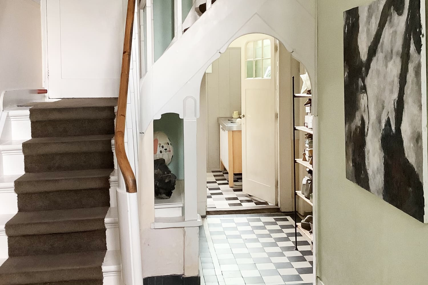 A 1904 Dutch Canal House Has Over 22 Lamps, Quirky Art, and Very Unique Tiles